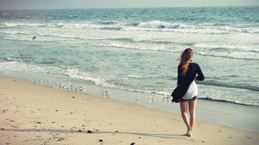 Girl walking on the beach